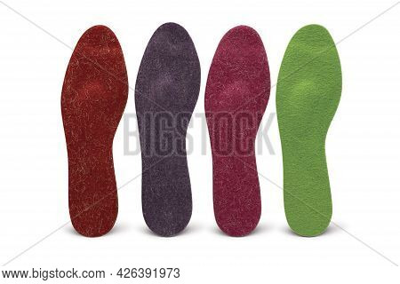 Multicolored Insoles On A White Background. Treatment And Prevention Of Flat Feet And Foot Diseases.