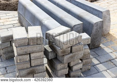Pavement Repair And Laying Of Paving Slabs On The Walkway, Stacked Tile Cubes On The Background. Lay