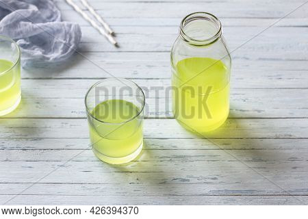 Healthy Dietary Milk Whey In Glass And Bottle On Light Blue Background