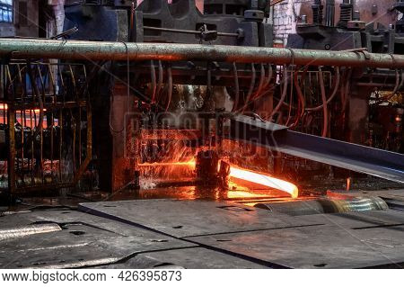 The Process Of Rolling Hot Rolled Steel In A Rolling Mill.