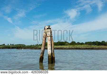 Marker For The Waterway At The Lagoon In Venice Under Blue Sky