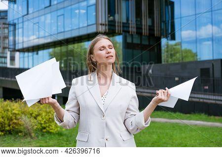 Beautiful Young Suburban Business Woman Walking In Classic Urban Office Buildings Holding Paper Docu