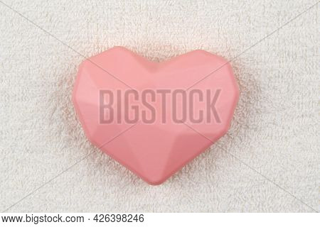 Pink Soap In The Shape Of A Heart On The Background Of A White Terry Towel.the Concept Of A Spa, Sau