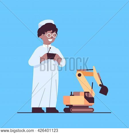 Arab Schoolboy Playing With Radio Controlled Tractor Toy Smiling Boy Having Fun Full Length