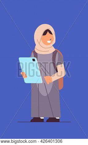 Arab Schoolgirl Using Tablet Pc Smiling Girl With Gadget