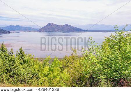 Montenegro, Skadar Lake National Park. View Of Lake Skadar On Cloudy Spring Day