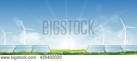 Windmill Farm And Solar Panel For Electric Power Productions On Green Grass Fields,spring Morning Sk