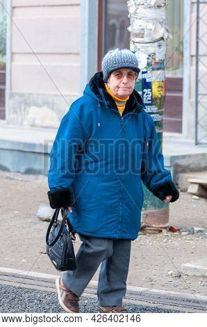 Timisoara, Romania - January 21, 2015: Woman Walking On The Street. Real People.