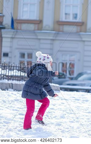 Timisoara, Romania - January 30, 2014: Kids Playing With Snow In The Street. Real People.