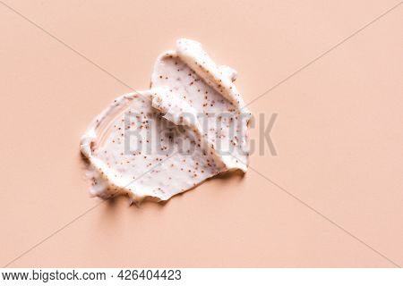 Sample Of Natural Scrub On Nude Pink Background. Peeling Cream With Microcapsules. Peach Or Coffee S