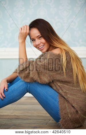 Portrait Of A Beautiful Woman Sitting On Floor