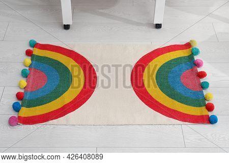 Stylish Rug With Rainbow On Floor Indoors