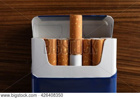 Pack Of Cigarettes On Wooden Table, Top View