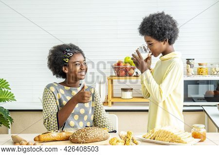 Two Cute Adorable Siblings African American Children Having Breakfast With Milk At Kitchen, Portrait