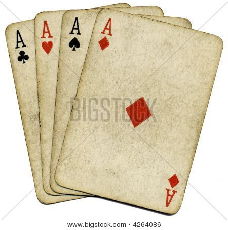 Four Old Vintage Dirty Aces Poker Cards, Isolated Over White.