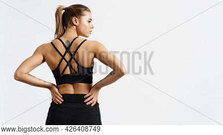 Portrait Of Female Athlete Doing Workout. Woman In Fitness Wear With Hands On Waist On White Backgro