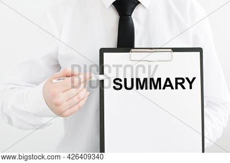Summary Text On A Tablet In The Hands Of A Businessman On A Gray Background, Pointing To The Inscrip