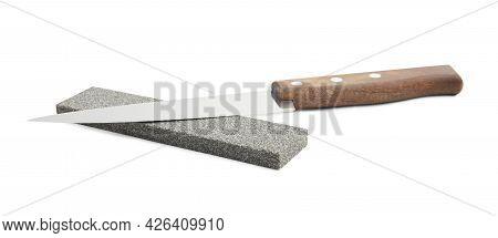 Sharpening Stone And Knife On White Background