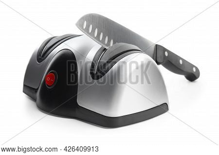 Modern Electrical Sharpener And Knife On White Background