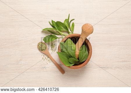 Fresh And Dried Broadleaf Plantain Leaves On Light Wooden Table, Flat Lay