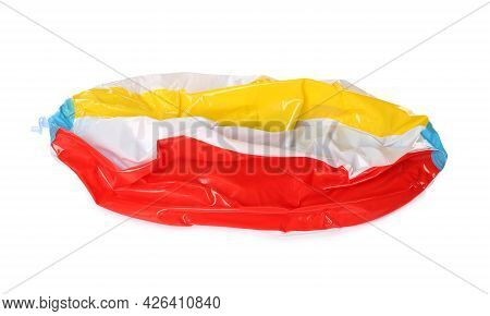 Deflated Colorful Beach Ball Isolated On White
