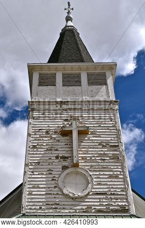 The Old Church Steeple Is In Need Of Fresh Paint After Years Of Neglect