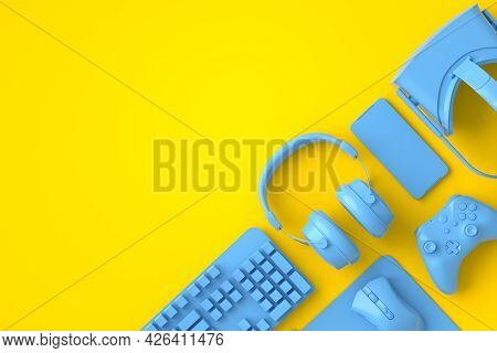 Top View Of Gamer Workspace And Monochrome Blue Gear Like Mouse, Keyboard, Joystick, Headset, Vr Hea