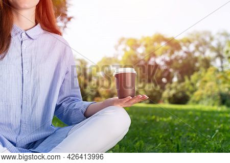Redhead Woman Drinking Coffee In Summer Park. Close Up Girl Hand Holding Takeaway Paper Cup. Beautif
