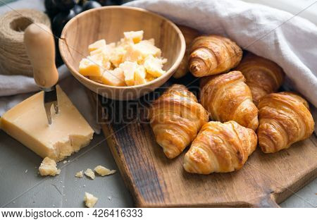 Croissants Whit Delicious Cheese And Grapes For Tasty Breakfast. Original Tasty French Croissants Wi