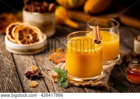 Pumpkin And Orange Fall Cocktail With Cinnamon