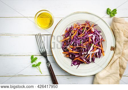 Fresh Coleslaw Salad Made Of Shredded Red And White Cabbage And Carrots On White Wooden Background,