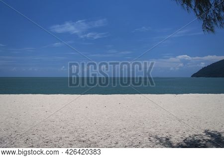 Kearchut Beach Within Penang National Park In George Town Penang Malaysia On A Summer Sunny Day.