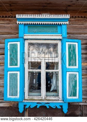 Close-up Of A Window With Blue Shutters. Vintage Rural Architecture, Decor, Vintage