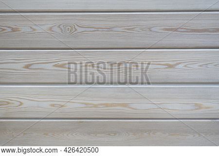 Close-up Of A Clapboard Wall. Treated Wood, Horizontal Lines. It Can Be Used As A Wooden Background