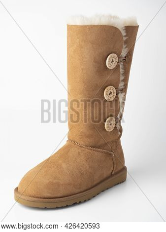 10.04.2021 Russia, Moscow. Close-up Of Ugg High Sheepskin Boot On A White Background. Warm Shoes, St