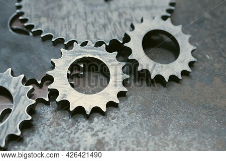 Steel Gray Gears On Steel Surface, Steel Scratched Surface. Rough Metal Prongs