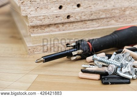 Screwdriver With Removable Nozzles And Parts For Assembling Furniture On Parts Of Cabinet Furniture