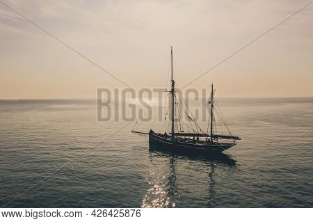 At Sea, Cornwall, Uk - June 30, 2021.  A Beautiful Tall Ship Floating On A Calm Ocean At Sunset With