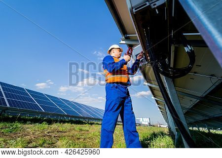 The Inspector Checks The Actual Output Voltage Level Of Inverter
