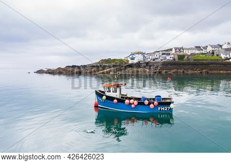 Coverack, Cornwall, Uk - June 24, 2021.   A Traditional Cornish Fishing Boat Outside The Harbour Of