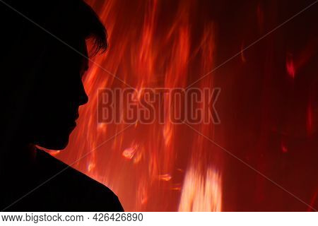 Fire Accident. Global Warming. Forest Blaze. Anxiety Depression. Dark Silhouette Of Sad Hopeless Man