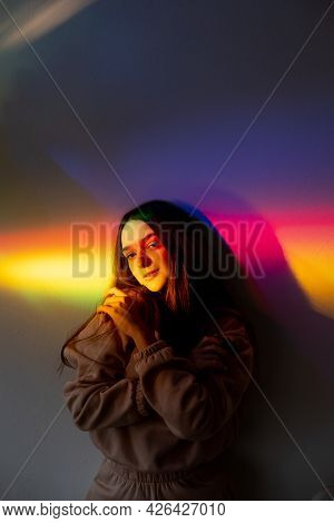 Neon Portrait. Self Love. Positive Mind. Peaceful Energy. Young Calm Satisfied Girl Embracing On Sof