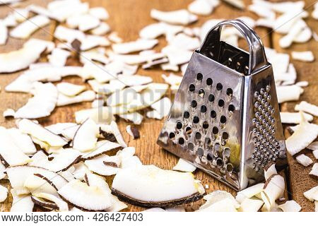 Grated Coconut And Coconut Pieces Chair Dessert, Coconut Texture And Small Grater