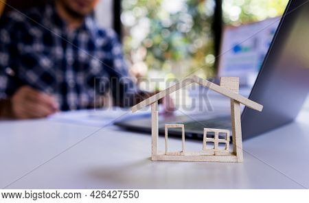 Model House With Background Businessman Working About Housing, Property, Loan House.