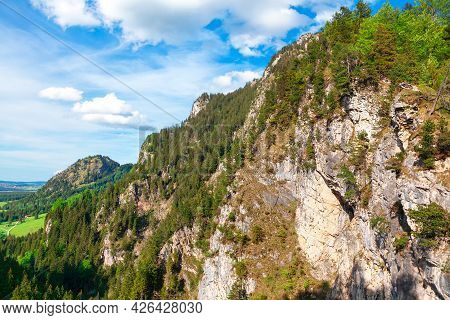 Scenic View Of Rocks And Alps Bavaria Germany . Coniferous Forest Growing On The Mountain