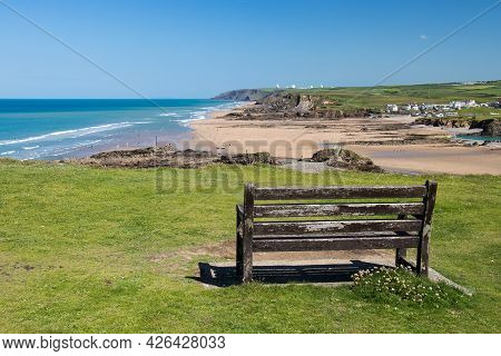 Wooden Bench On A Grassy Cliff Overlooking The Sea, Beaches, Cliffs, Hotels, Sea-pool And Fields Bey