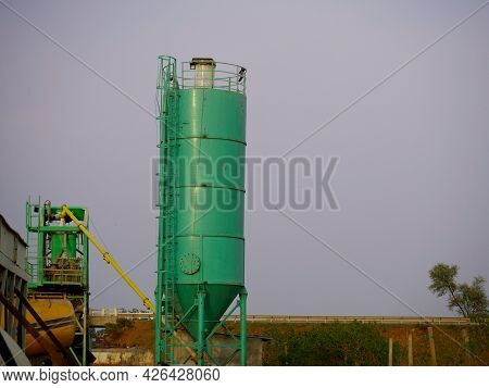Concrete Mixer Cylinder For Construction Work Presenting Around Sky Industrial Backdrop.