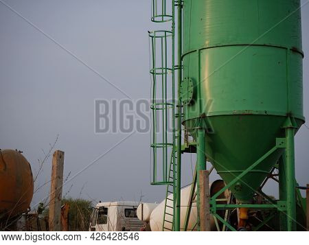 Asian Concrete Mixer Machine Presenting Around Sky Industrial Background.