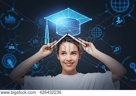 Smiling Businesswoman Holding An Open Book On Her Head And Pondering About Educational Prospective I