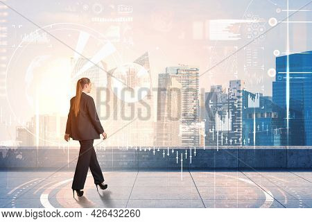 Businesswoman In Formal Suit Walking Along Rooftop, Terrace In Singapore. Skyscrapers And Hologram S